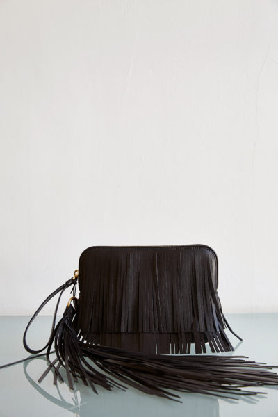small clutch with long fringe detail